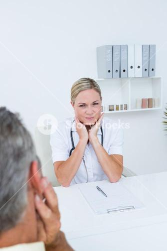 Doctor examining patient with neck ache
