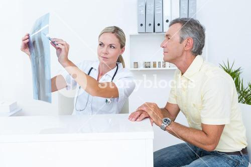 Doctor showing Xrays to her patient