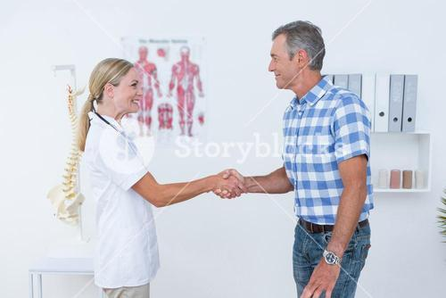 Patient shaking hands with doctor