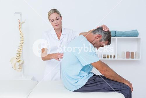 Doctor stretching a man back