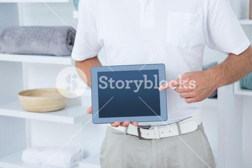 Doctor showing laptop pc