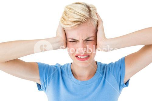 Furious blonde woman holding her head