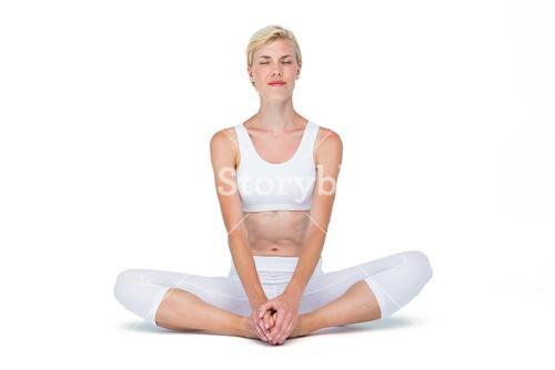 Fit woman meditating eyes closed