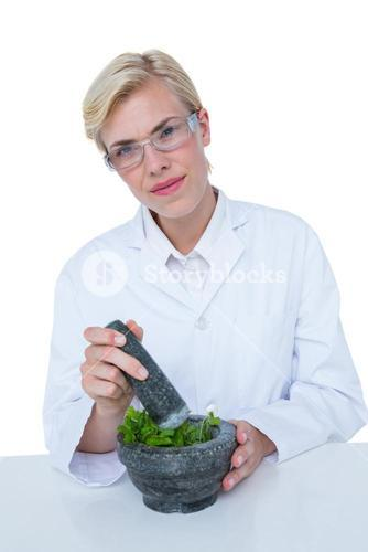 Doctor mixing herbs with mortar and pestle