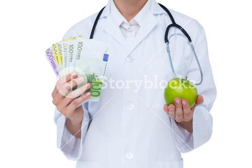 Doctor holding cash and green apple