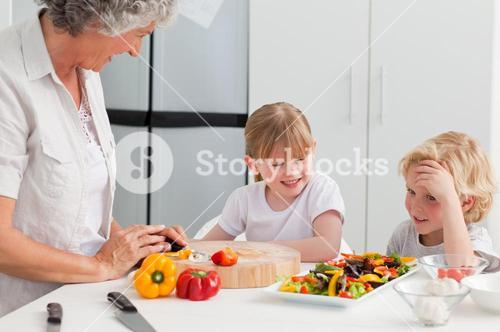 Children cooking with their grandmother