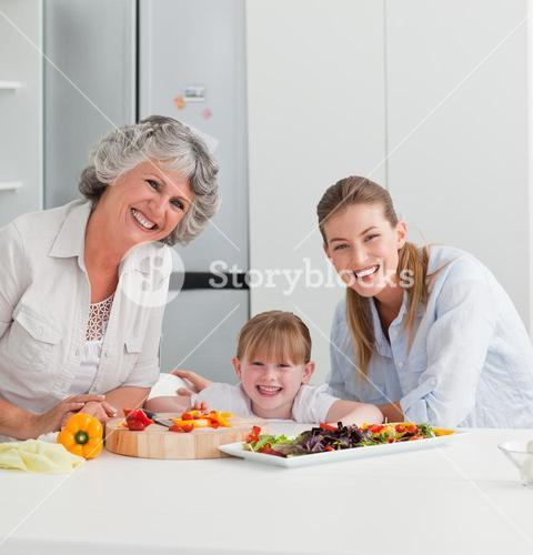 Family cooking together in the kitchen at home