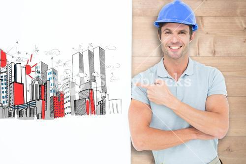 Composite image of smiling architect with bill board over white background