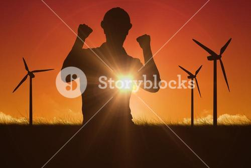 Composite image of excited manual worker clenching fists