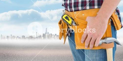 Composite image of close-up of male repairman wearing tool belt
