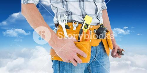 Composite image of cropped image of technician with tool belt around waist