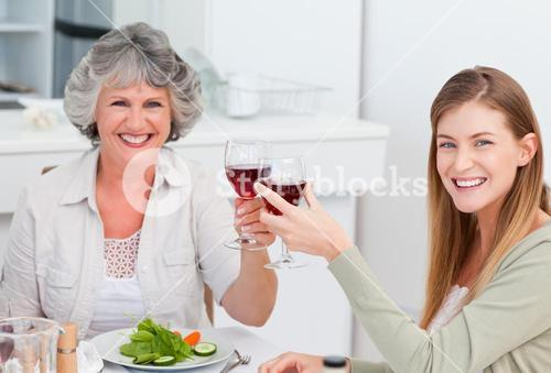 Woman drinking with her mother