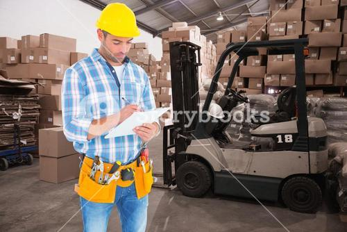 Composite image of manual worker writing on clipboard