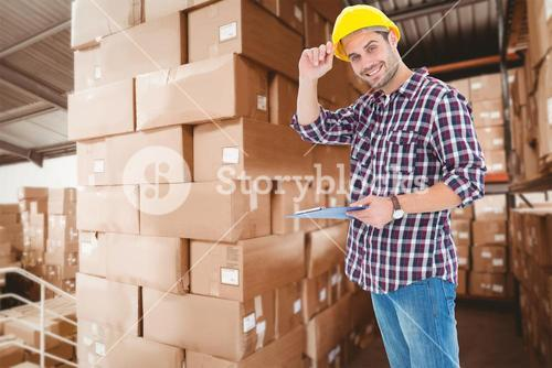Composite image of happy repairman wearing hard hat while holding clipboard