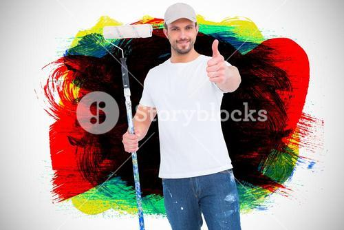 Composite image of handyman holding paint roller