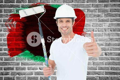 Composite image of man holding paint roller while gesturing thumbs up