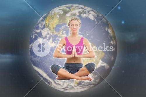 Composite image of calm blonde sitting in lotus pose with hands together