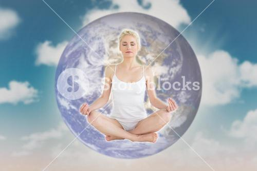 Composite image of toned young woman sitting in lotus pose with eyes closed
