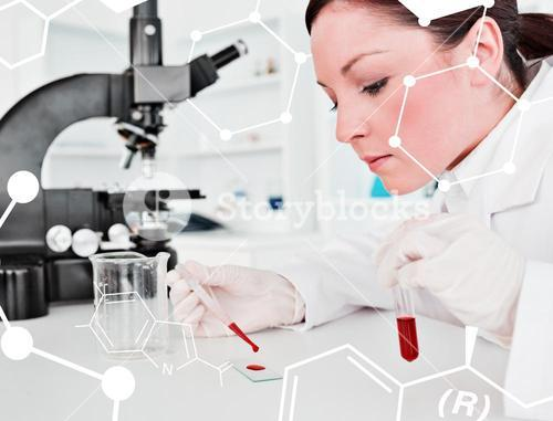 Composite image of cute redhaired female scientist doing an experiment in a lab