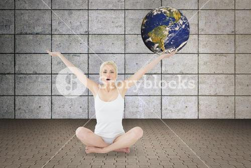 Composite image of toned young woman sitting with arms outstretched
