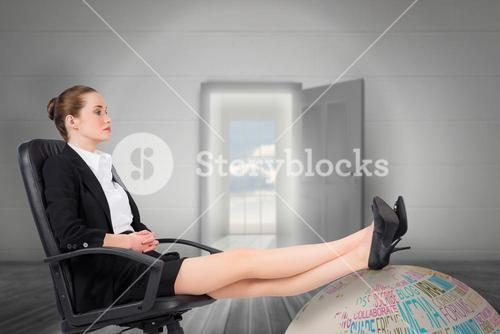 Composite image of businesswoman sitting on swivel chair with feet up