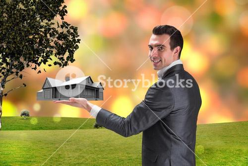 Composite image of businessman presenting with hand