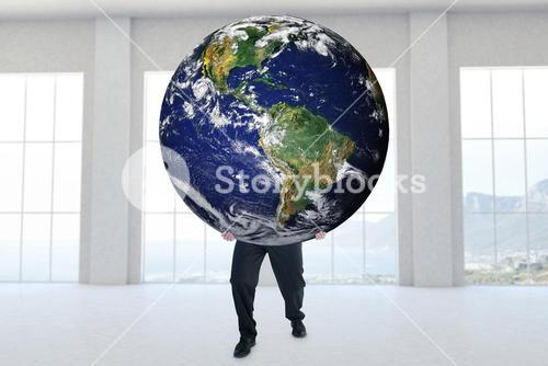 Composite image of businessman carrying the world