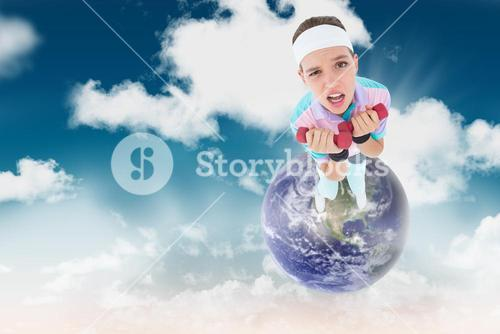 Composite image of hipster girl lifting dumbbells