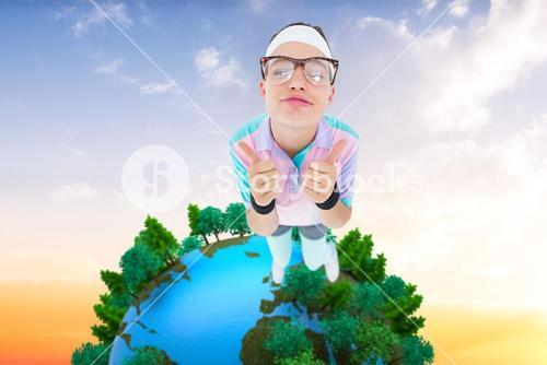 Composite image of smiling geeky hipster looking at camera thumbs up