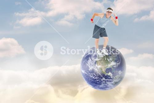 Composite image of geeky hipster posing in sportswear
