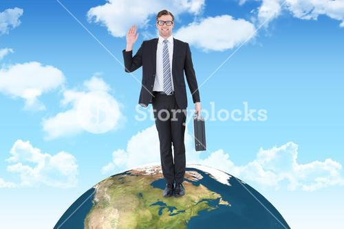 Composite image of geeky hipster businessman waving at camera