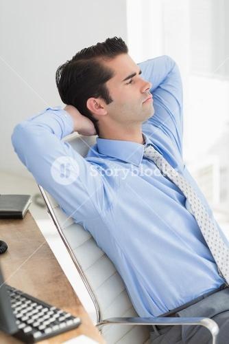 Businessman relaxing in his chair