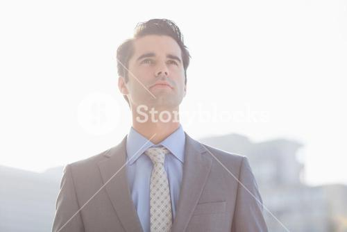 Businessman relaxing outside