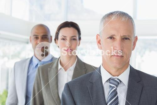 Business colleagues looking at camera