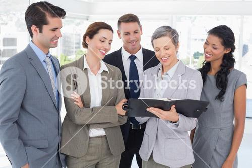 Business people looking together in the notebook