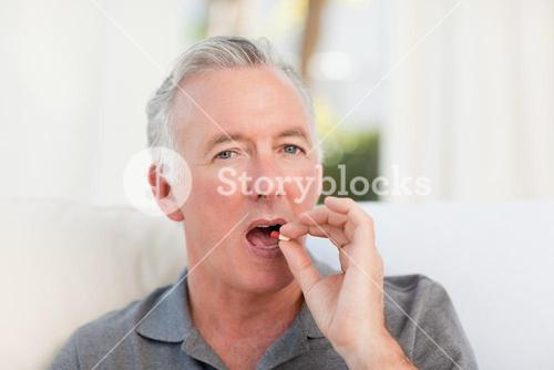 Retired man taking pills