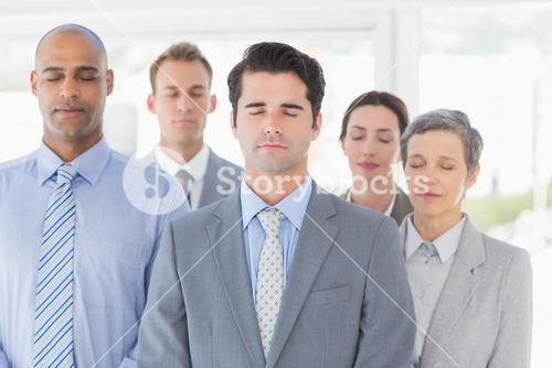 Business team relaxing eyes closed