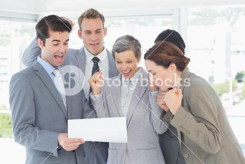 Business team celebrating a new contract