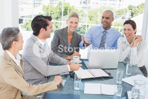 Happy business team having a meeting