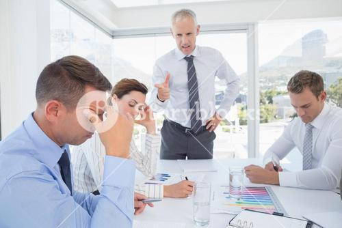 Businessman yelling at his team