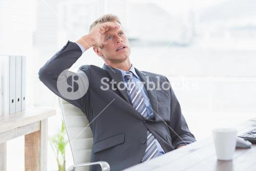 Businessman with his hand on his forehead
