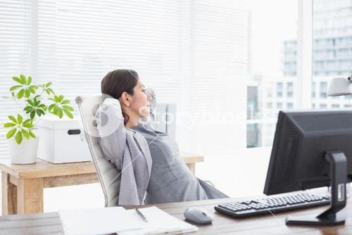 Businesswoman relaxing in a swivel chair