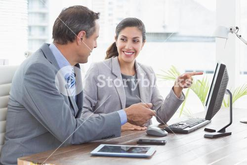 Businesswoman working with team mate