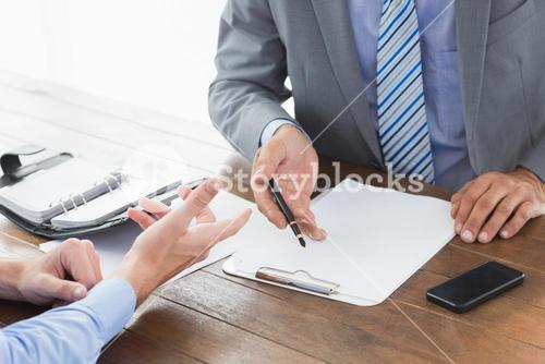 Businessman explaining contract to co worker