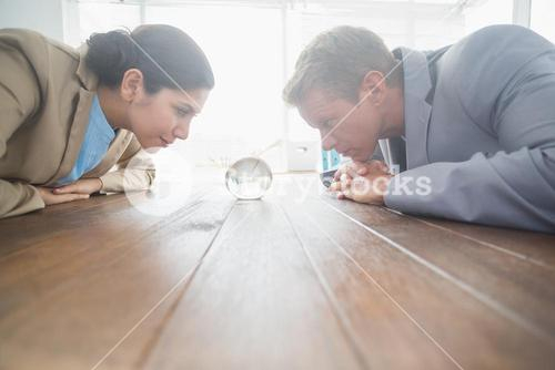 Business partners watching crystal ball