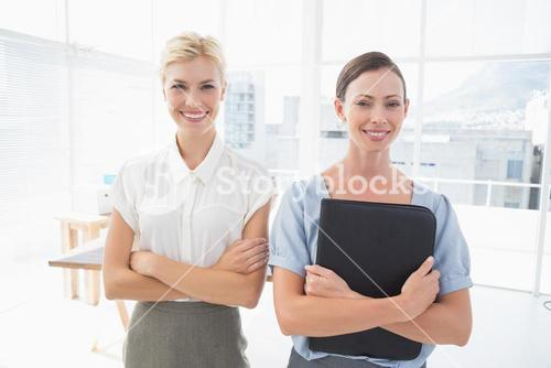 Smiling businesswomen looking at camera