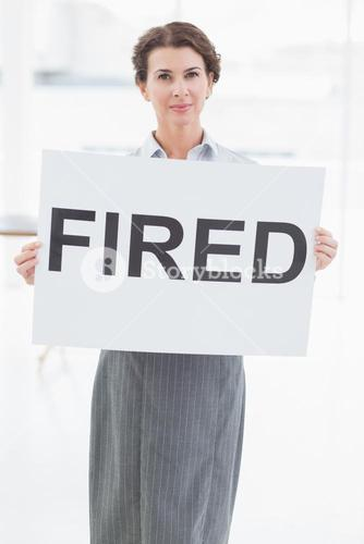 Businesswoman holding sign in front of her