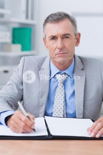 Unhappy businessman looking at camera