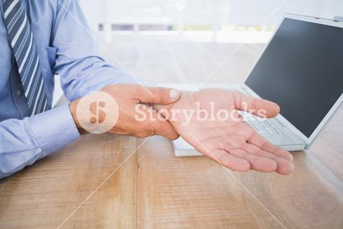 businessman with hand pain