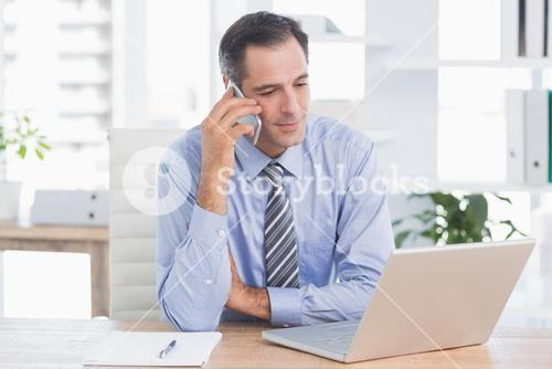 businessman phoning at his desk